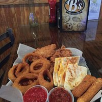 Sampler platter, Quesadilla, onion rings, chicken tenders, mozzarella sticks. Your choice of dipping sauces.