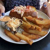 Buttered lobster roll with thick cut fries