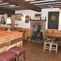 Bar with a roaring log burner