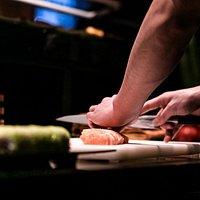 Chef cutting sushi