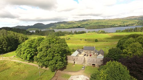 Finchairn Farmhouse with Loch Awe in the background.