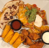 The El Gallo Sampler - cheese quesadillas, nachos, chicken taquitos, and wings.