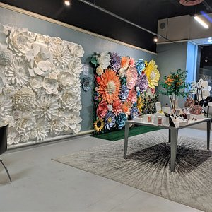 We are an interactive Gallery. Come in and take photos with our beautiful paper flower walls & backdrop's