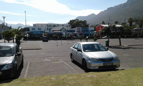 Parking at main beach with cafes in the background