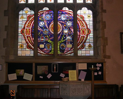 Millenium window (2004) and stone font (1662) inside St. Oswald's Church (Oswestry)
