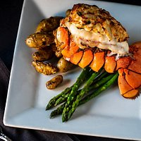Cold water 6 oz lobster tail topped with jumbo lump crab cakes. Served with a side of asparagus and roasted fingerling potatoes.