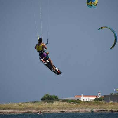 kitesurf jumping at Nissakia Loutsa, one of the main kitesurf spots in Athens that Works with North wind called Meltemi from the Aegean Sea.