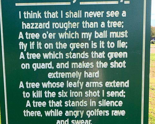 Well placed sign in front of a significant tree in front of the 4th green.