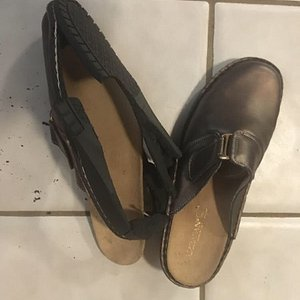 The sole on the right footed shoe completely separated and the left footed shoe started too, also.  Clearly, these shoes have been in storage for a long time.  We can understand how they might have been sold accidentally, but we can't understand the lack of cooperation from the store.