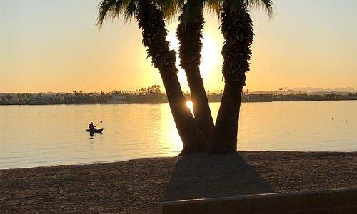 the sun sinks behind the horizon