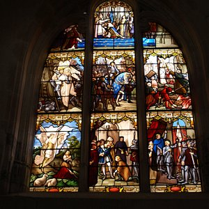 Stained glass window depicting scenes from the life of Joan of Arc by the Atelier Vermonet, Reims, 1899