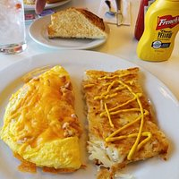Ham and cheese omlet with hash browns and toast.