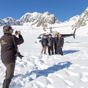 1, 2,3 and everybody smile. Time for a photo with HeliServices.NZ Pilot Dion capturing the perfect shot
