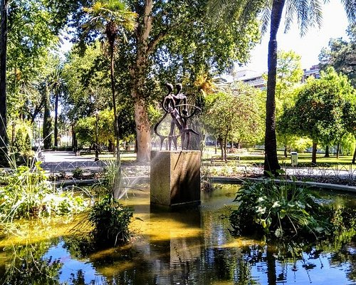 Shady lake and sculpture