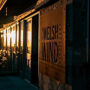 A West Wales sunset reflected in the distillery windows