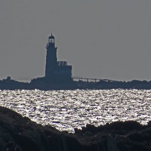 Halfway Rock Lighthouse is in Casco Bay south of Land's End off the southern tip of Bailey Island in Harpswell, Maine.