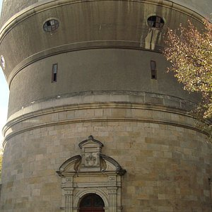 The old water tower has a massive structure.