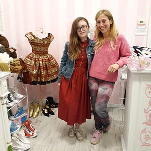 My daughter wearing her new Austrian traditional dress that she found at Pretty Inside. She's standing next to the owner who helped us find the right one :)