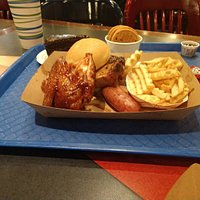 Combination meal consists of chicken, ribs, and sausage.