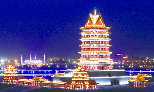 """Yellow River Tower is a landmark architecture standing 108-meter tall on the golden riverbanks of the Ningxia reach of the Yellow River.The visitors get to ascend to the top by walking up the stairs and have the whole picture of """"The Yellow River only enriches Ningxia"""".Tts construction rendered obsolete the old saying""""Eight River Towers in China but None along the Yellow River""""."""