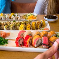 Enjoying our delicious sushi rolls in Zumo Food & Drink
