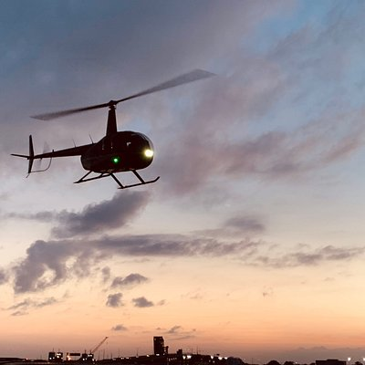 Helicopter Takeoff at Sunset