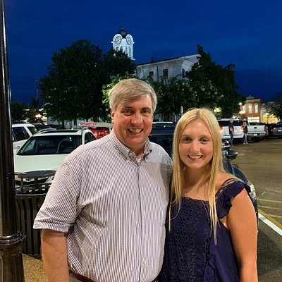 My daughter and I with the courthouse behind