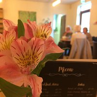 Our menu and centrepiece with some lunchtime regulars in the background.