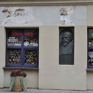 It's our cosy shop. Welcome! On the façade is the bas-relief of a famous Lithuanian composer Juozas Naujalis.