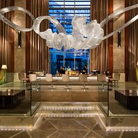 The heart of the hotel, this elegant lounge is a vibrant place with its naturally lit ambience and the JW sculpture, a chandelier which consists of 35,330 custom glass made tubes hung from the ceiling using stainless steel aircraft cables.
