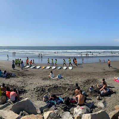 Surf class warm-up on the beach