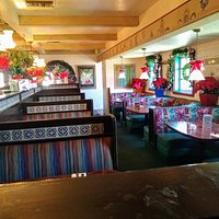 Dining room of Rodrigo's Mexican Grill in Fullerton, CA decorated for Christmas.