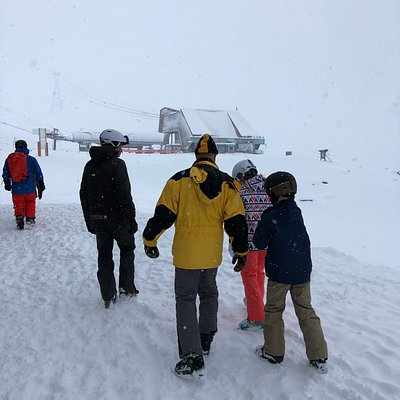 Our instructor (in black) escorting my family to the gondola and our station after a good day of work with us.