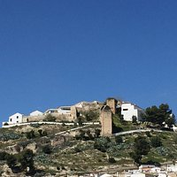 A castle at the top of the hill in Baena.
