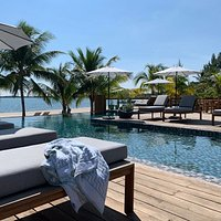 Grab a towel, claim a chair, and enjoy a day relaxing by our pool overlooking the Caribbean Sea.
