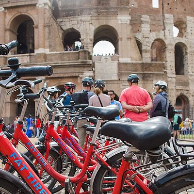 While diving into the fascinating ancient history of the Colosseum, the comfortable cruiser bikes wait to take the group to the next stop...