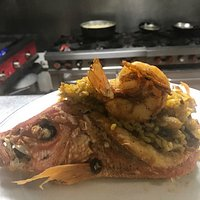 Fresh local de-boned red snapper stuffed with our seafood paella.