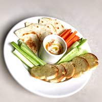 Hummus Platter: House made hummus served with assorted vegetables, crostini and flatbread. (VEGAN)