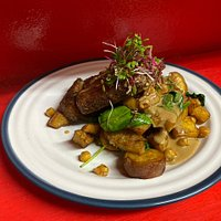 Wood fire 250g matured Sirloin served with deep fried Sweet potato, baby Spinach, Chickpeas and a Café au Lai sauce