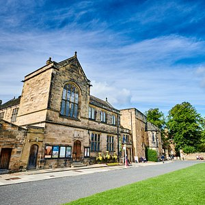 External view of Palace Green Library and Durham castle entrance to the right