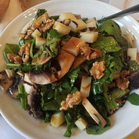 nice salad with arugula ανδ musshrooms