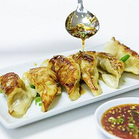 Yummy Chinese Dumplings with homemade sauce.