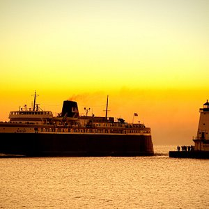 A beautiful evening sunset as the Badger enters the harbor in Ludington, MI.