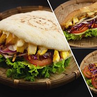 Pita bread, wrap and banh mi with juicy roasted chicken, fresh veggies and homemade sauces.