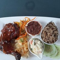 BBQ chicken, macaroni cheese, coleslaw beans, rice and peas with salad and cucumber