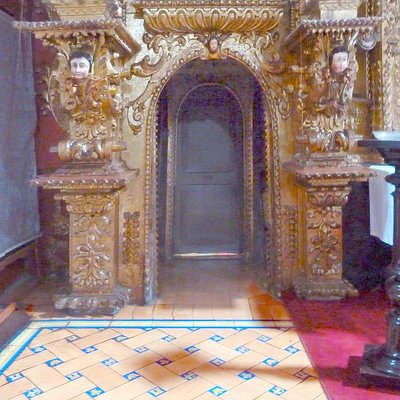 The left side of the altar, also covered with gold leaf, and a beautiful tile floor