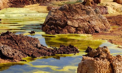 The Danakil Depression is the northern part of the Afar Triangle or Afar Depression in Ethiopia,[1][2] a geological depression that has resulted from the divergence of three tectonic plates in the Horn of Africa.  www.eshoomovalleytours.com Call Us on WhatsApp,+251961627110