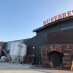 The new Buffalo Bayou Brewing Co. brewery with iconic buffalo gate.