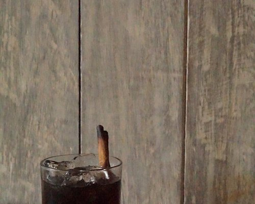 This drink inspired by clasic old fashioned cocktail its combine of spice arak bali flavour,cendana and charcoal syrup smokeed with coffee wood.
