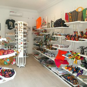 'TOP-SHOP Selections' - In the entrance of Senegambia Beach Hotel! Offering summer wear, as well as African arts, crafts and souvenirs